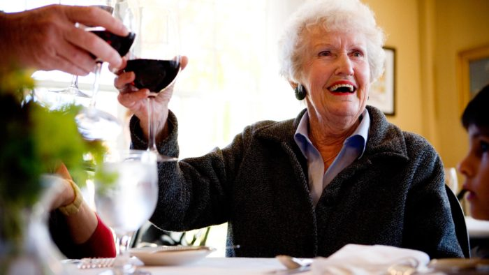 Faces Of Joy Old Woman With Wine
